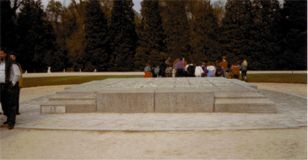 "Central granite block, Compiègne, Glade of the Armistice, inscribed: ""Here on 11th November 1918 perished the criminal pride of the German Empire defeated by the free people whom it set out to enslave."""