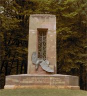 Alsatian monument to French soldiers. Compi�gne. Glade of the Armistice. At three PM on June 21, 1940, Hitler walked past this memorial, its skewered eagle bedecked with red Reich flags bearing black swastikas.